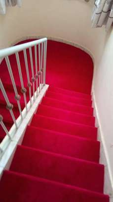 RED CARPETING ON YOUR STAIR CASES image 2