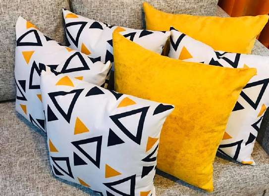 Throw pillows yellow and white  with black shade