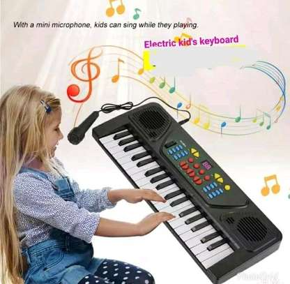 37 keys electric kids keyboard with a microphone image 1