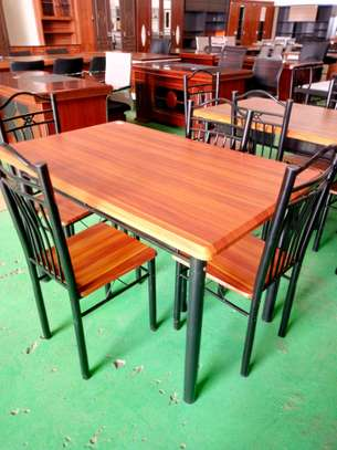 4seaters dining table wooden top and seats