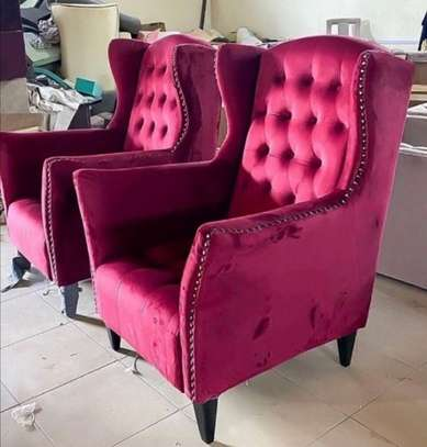 Maroon wing chair. image 1