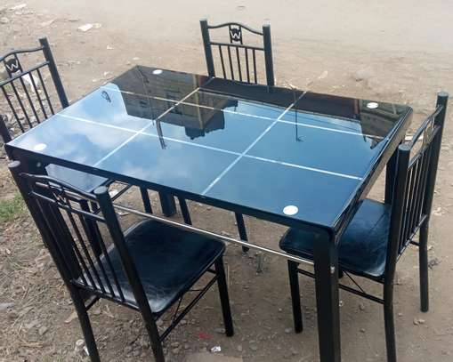 A set of dining table with chairs image 1