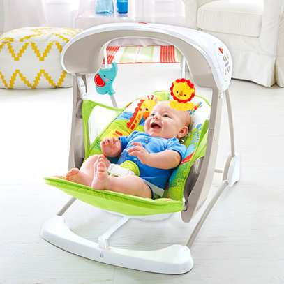 """Rainforest Friends Take-Along Electric Swing/Rocker & Seat, Soothing & Fun. Either way it's """"2-in-1."""