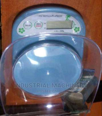 An Electronic Kitchen Scale With Bowl image 1