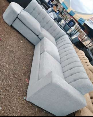 White l-shaped  back permanent  seven seater sofa. image 1