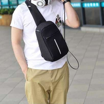 Anti theft cross body backpack (single strap with a USB charging port image 2