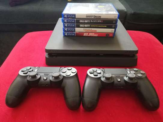 PS4 Slim with 1TB storage,  2 controllers + 5 Games image 1