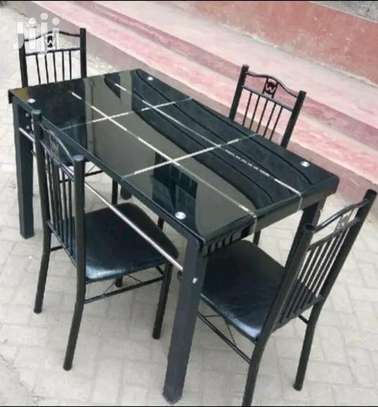 Guaranteed quality glass dining table with 4 chairs for sale image 1