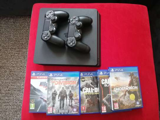 PS4 Slim with 1TB storage,  2 controllers + 5 Games image 4
