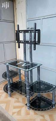 Double sided tv stand cabinet with black brackets image 1