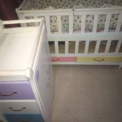 Baby crib, chest of matching drawers, mattress, side bumpers and mosquito net
