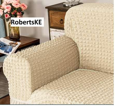 Beige elastic sofa cover 5 sitter image 1