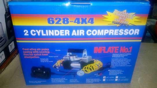 Double cylinder compressor
