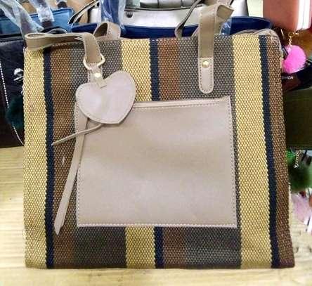 Multi colored handbags image 1
