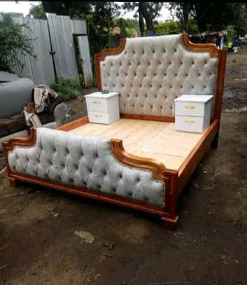 Mahogany tufted bed image 1