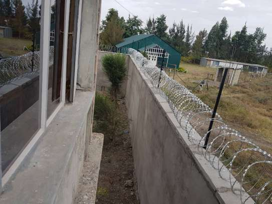 Electric fence and Razor wire installation at affordabe Rates image 3