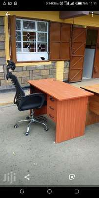 An office desk plus black adjustable office chair with strong arms image 1