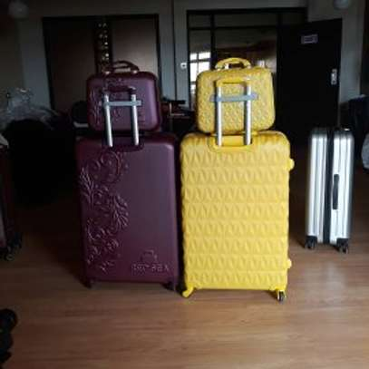 Suitcases and laptops bags image 3
