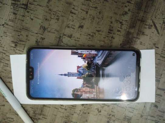 Used smartphone, looks new, no scratches, all accessories available. image 3