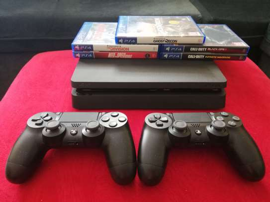 PS4 Slim with 1TB storage,  2 controllers + 5 Games image 2