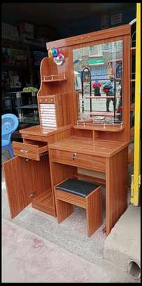 Lighted dressing table with a sitting on stool image 1