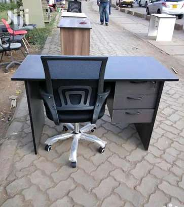 Computer use office table plus an adjustable low back office seat image 1