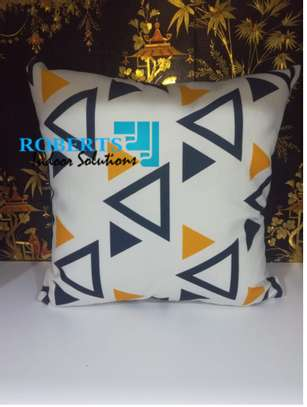 white with triangle throw pillows image 1