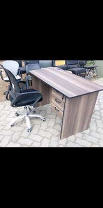 An office desk plus black office chair with arms image 1