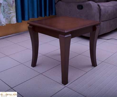 Coffee table almond brown sleek legs image 1
