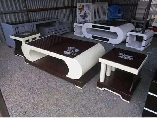 Coffee table with two stools