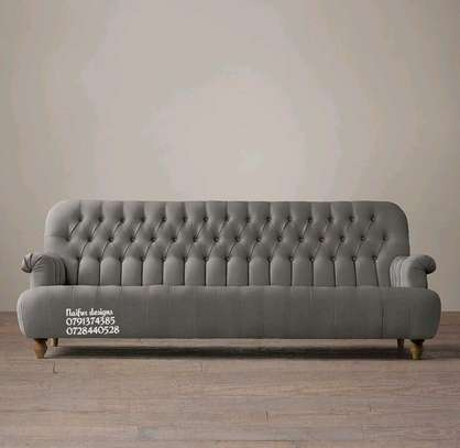 Modern grey three seater sofas/tufted seats image 1