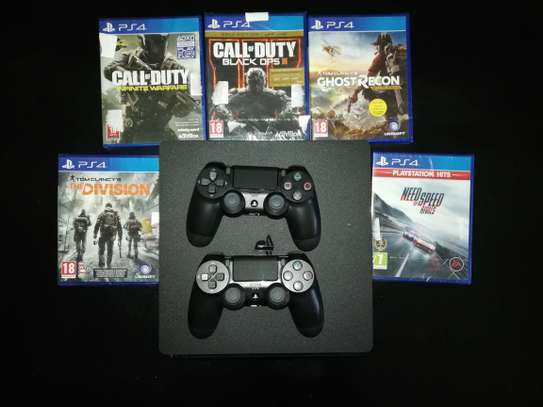 PS4 Slim with 1TB storage,  2 controllers + 5 Games image 3