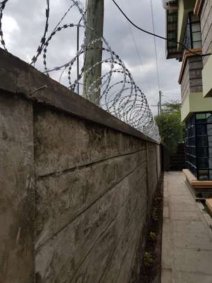 Razor wire (10 meters) installation in ngong image 2