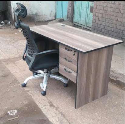Computer desk with lockable drawer and a high back black office chair image 1