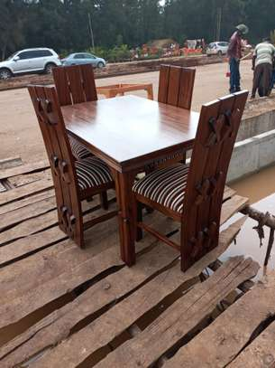4 seater dining table. image 1