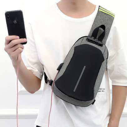 Anti-theft cross body backpack (single strap) with a USB charging port. image 2
