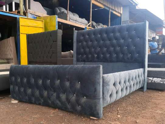 Gray Chesterfield bed image 1
