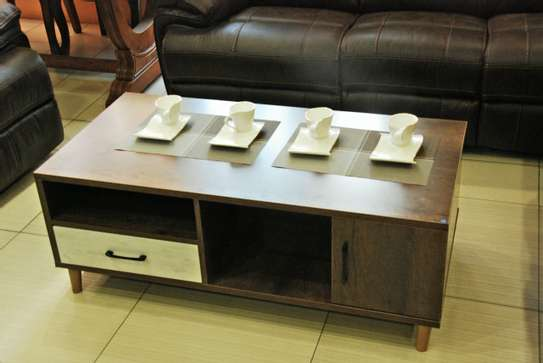 Brown coffee table with white drawer image 1