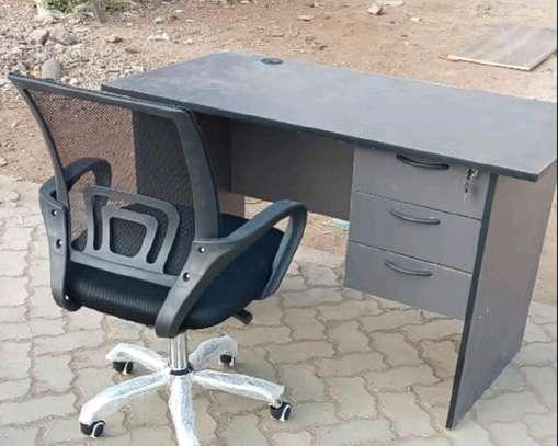 An office desk plus clean swivel office chair image 1