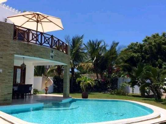 3 bedroom fully furnished own compound image 2