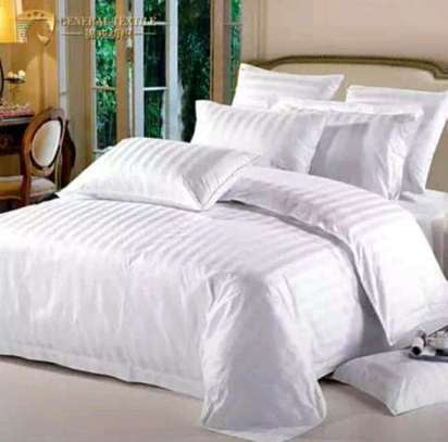 PLAIN WHITE COTTON DUVETS WITH 1 BEDSHEET AND 2 PILLOW CASES image 2