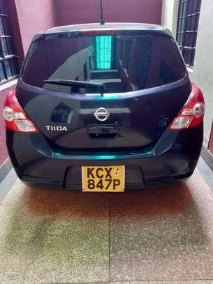 A clean black Nissan Tiida