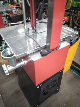 BRAND NEW BONE SAW WITH A MEAT MINCER. image 1