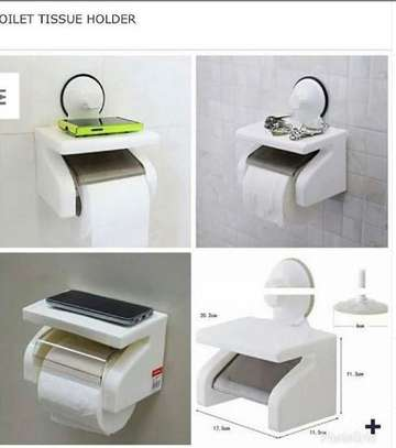 Toilet tissue holder with phone rest