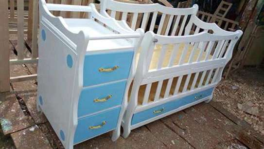 Baby cot with mattress and net and get a free delivery image 1