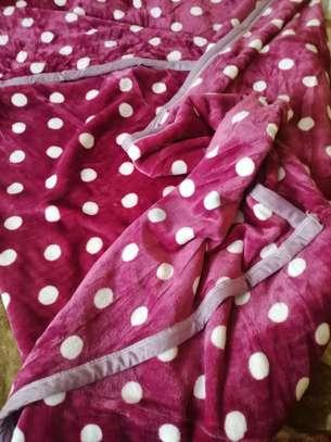 Fleece blankets and warmers image 8