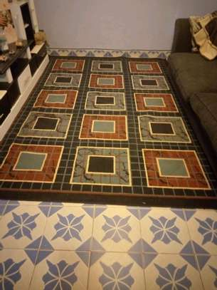 A Beautiful Carpet with Red and Blue Pattern. image 1