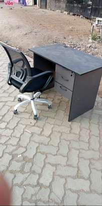 An office desk of 3 drawers plus an adjustable office chair image 1