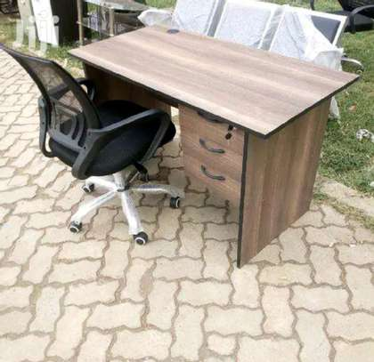 An office desk with mesh computer chair image 1