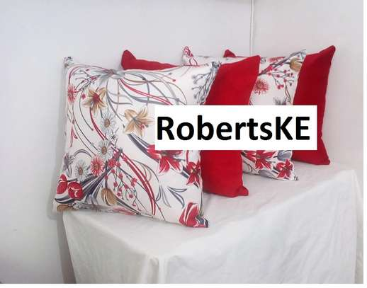 red with flowered throw pillows image 1